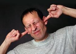 Ears man with fingers in ears